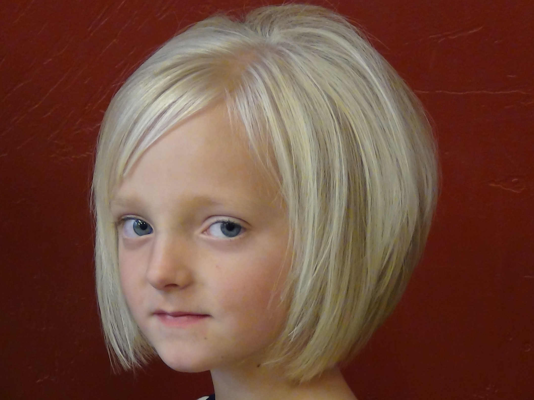 Cut short style into little girls hair and style boys and girls hair